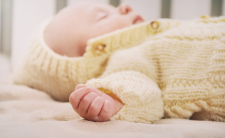 neonatal: sleeping cute newborn baby, maternity concept, soft image of beautiful family