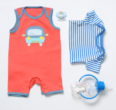 top view fashion trendy look of baby clothes and toy stuff, baby fashion concept 免版税图像