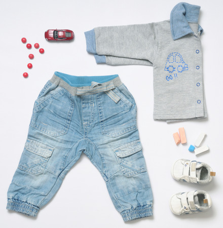 stuff toy: top view fashion trendy look of baby clothes and toy stuff, baby fashion concept Stock Photo