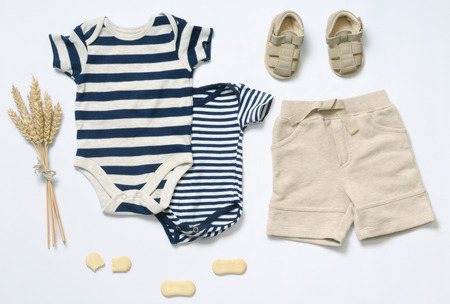 apparel: top view fashion trendy look of baby clothes and toy stuff, baby fashion concept Stock Photo