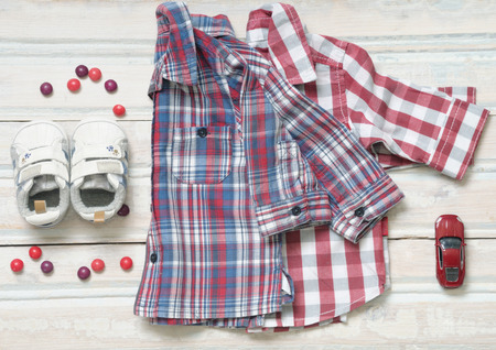 fashion style: top view fashion trendy look of baby clothes and toy stuff, baby fashion concept Stock Photo
