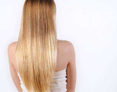 hair back: portrait of a beautiful young blonde woman with wonderful hair
