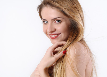 sensitive skin: fashion spa portrait of beautiful young blonde woman with perfect makeup and sensitive skin on white background.
