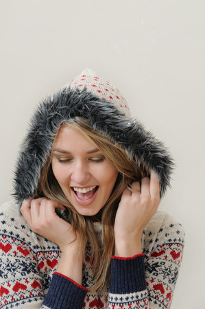 warm clothing: beauty face portrait of attractive smiling woman in warm clothing.