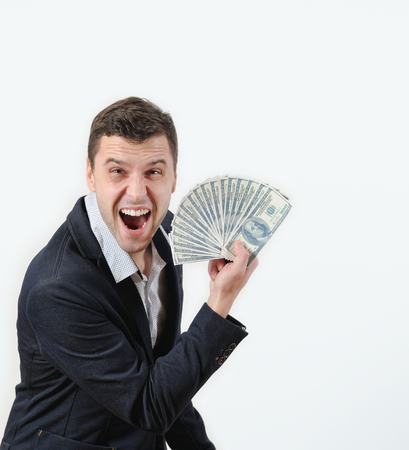 money background: happy businessman with money on a white background. Success concept