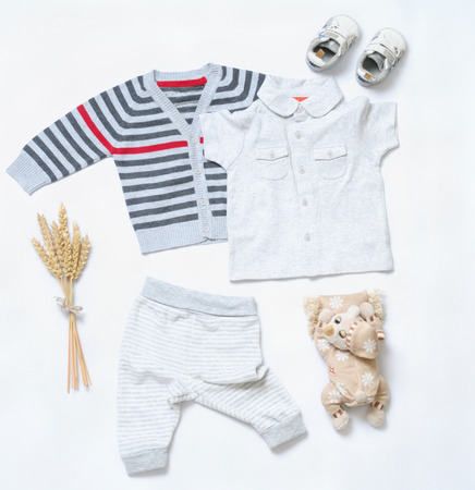 baby animal: top view fashion trendy look of baby clothes and toy stuff, baby fashion concept Stock Photo