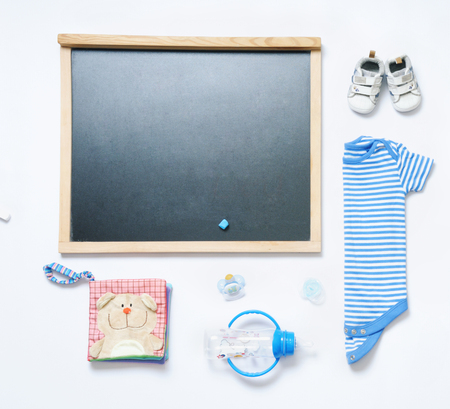 baby stuff: top view fashion trendy look of blackboard and baby stuff, baby fashion concept