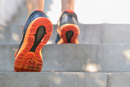 Low angle of female foots on stairs