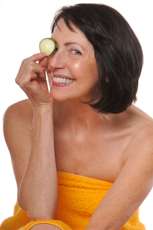 Portrait of happy senior woman with cucumber Zdjęcie Seryjne