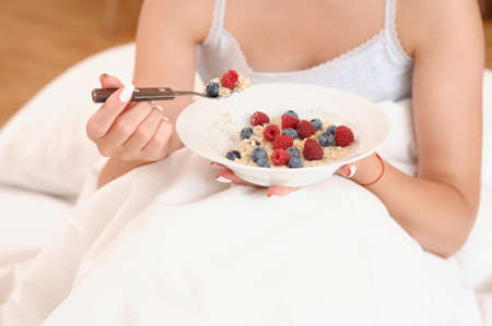 Close up shoot of oatmeal with berries for breakfast in the morning. Healthy lifestyle concept Stock Photo
