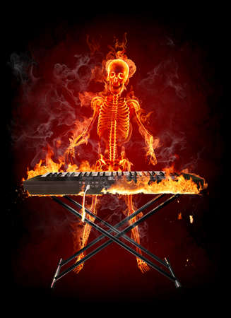 Fire skeleton play the keyboard Stock Photo