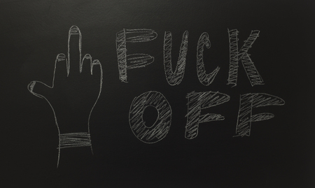 drawn middle hand with the text: FUCK OFF Foto de archivo