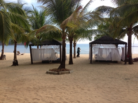 beside: its a one way to relax and to have a massage is beside the beach Stock Photo