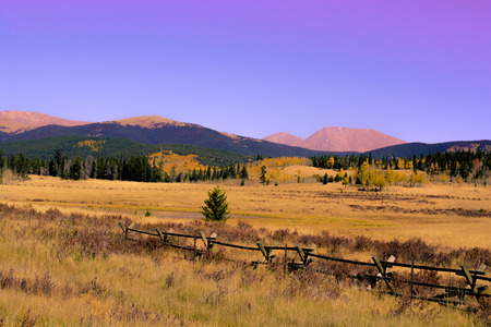 meadow with wooden fence near kenosha pass in colorado Stock Photo