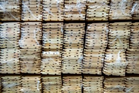 Raw material for the manufacture of furniture. Boards made of wood. Warehouse with wooden boards.