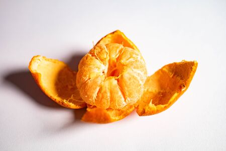 Bright juicy mandarin isolated on a white background