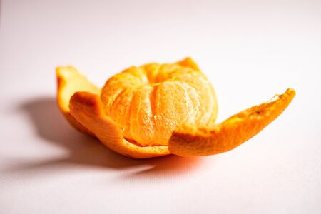 Bright juicy tangerine in the form of a flower isolated on a white background Фото со стока