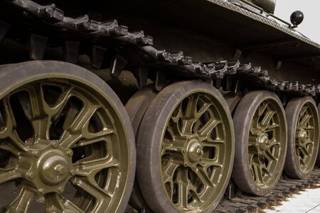 powerful caterpillars of an old restored military tank