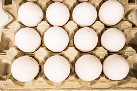 Eggs in a box. White eggs in a special paper container