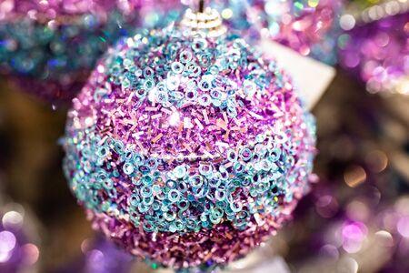 New Years holiday toy shiny ball. Christmas tree decoration. Фото со стока