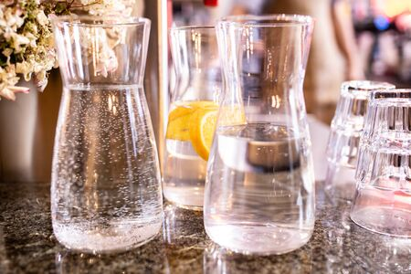 drinking water with lemon in crystal transparent jugs.
