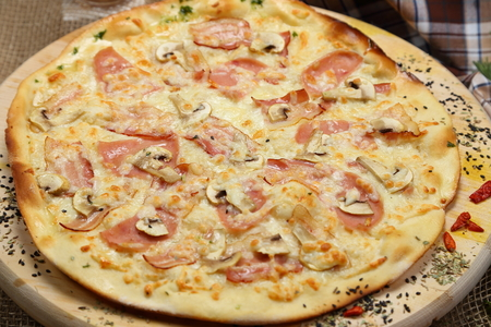 Pizza thin with sausage, mushrooms, cheese, spices