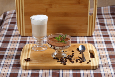 chocolate mousse with mint, a cup of coffee with cream