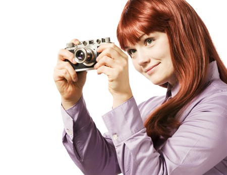 Young woman taking picture with a retro camera Stock Photo