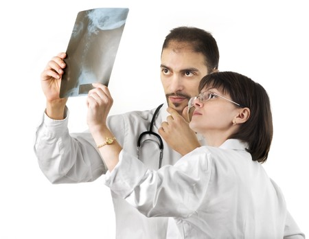 oncologist: Two doctors watching an xray over a white background Stock Photo
