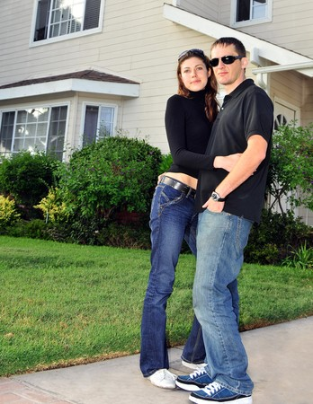 front house: young couple in front of house Stock Photo