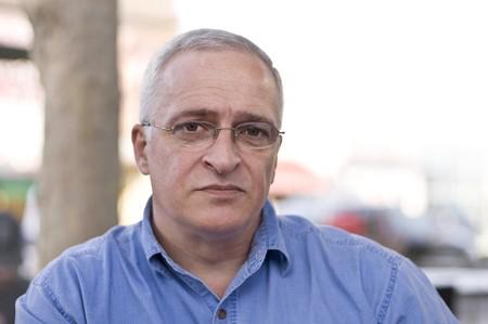 aging face: Close-up portrait of a sad senior man, shallow depth of field