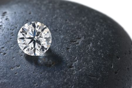 Close up of a diamond on the black stone photo