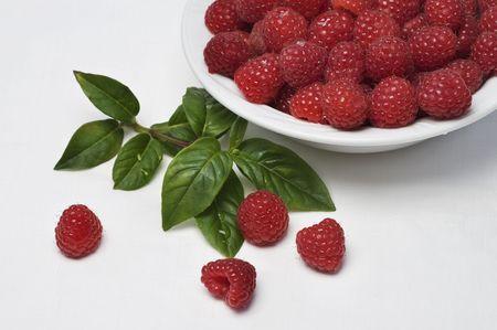 Fresh raspberries in bowl Stock Photo