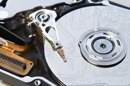electronic background: Harddisk with circuit reflections. Electronic Background