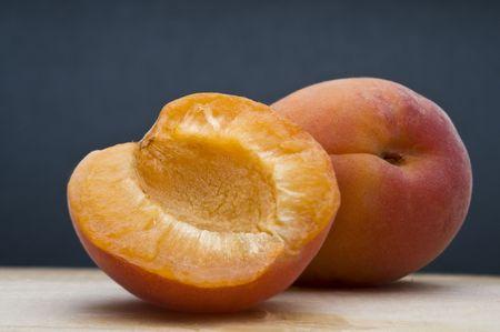 Fresh apricot on blue background Stock Photo