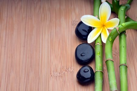 zen spa: Spa still life background, with flower, bamboo and massage stones