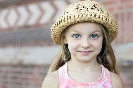 Portrait of a beautiful little girl in hat