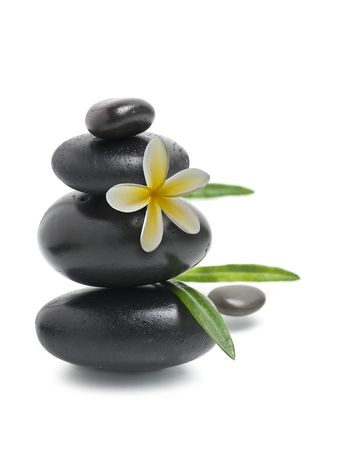 Spa still life, Stack of pebbles with yellow flower photo