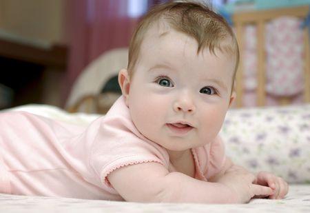 Closeup portrait of adorable baby girl photo