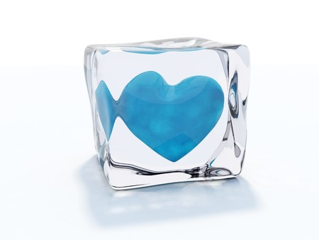 Blue heart frozen in ice cube isolated on white photo