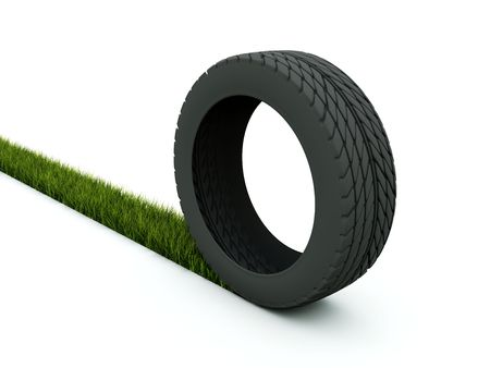 Tire with track from grass isolated on white photo