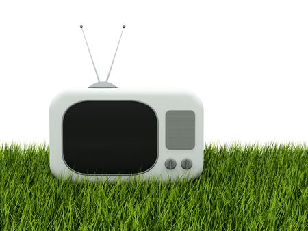programme: TV on green grass isolated on white Stock Photo