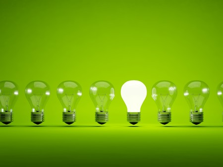 electric green: Turn on bulb on green background
