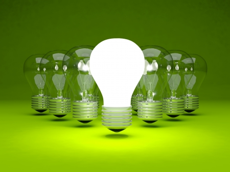 Group of light bulbs on green background photo