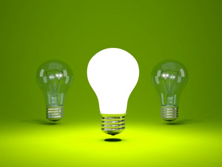 Light bulb on green background Stock Photo