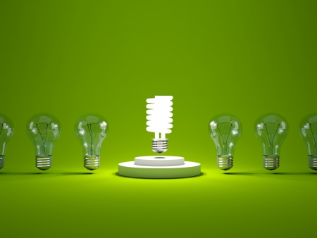 Energy efficient light bulb on podium  In a row with other bulbs photo