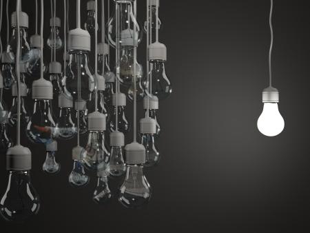 Bright light bulb on black background