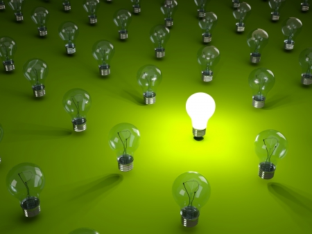 Rows of light bulbs on green background photo