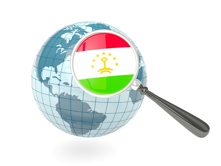 Magnified flag of tajikistan with blue globe isolated on white photo