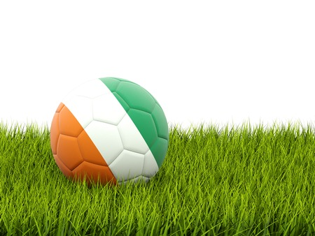cote d'ivoire: Football with flag of cote d Ivoire on green grass